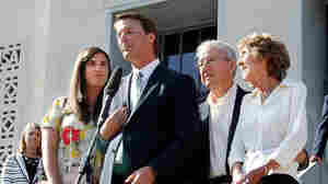 Former U.S. Sen. John Edwards addresses the media alongside his daughter Cate Edwards and his parents Wallace and Bobbie Edwards yesterday after the conclusion of his trial on campaign finance charges.