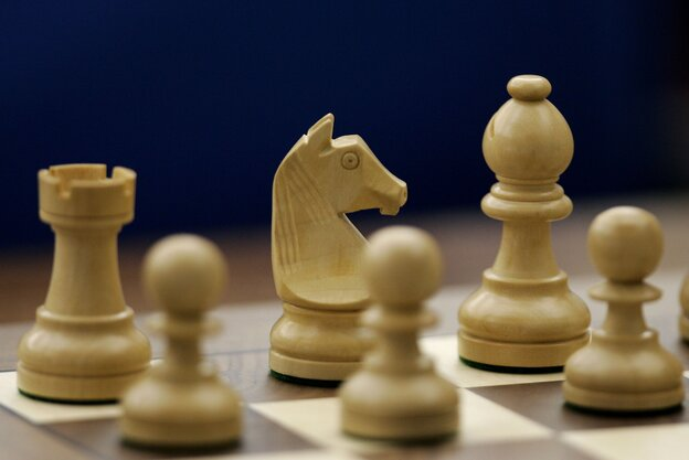 Chess pieces on a chess board.