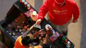 A fan of the St. Louis Cardinals buys a beer from a vendor prior to Game 3 of the World Series against the Detroit Tigers at Busch Stadium in 2006. At 56 cents an ounce, St. Louis is second only to Boston for the priciest ballpark brew in the country.