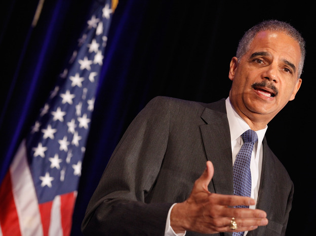 Attorney General Eric Holder addresses the Congressional Black Caucus Faith Leaders Summit and National Black Churches Annual Consultation on Wednesday in Washington. (Getty Images)