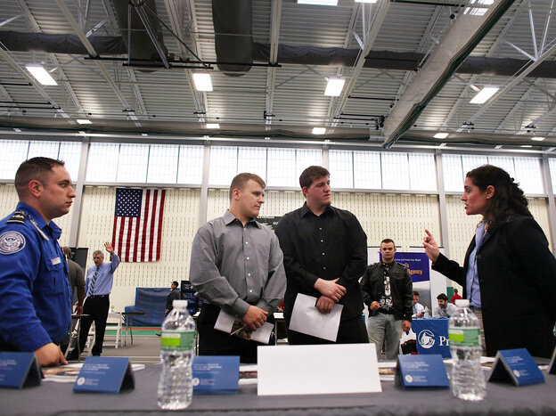 Military veterans Kris Hummel (l) and Shane Foley, speak with a TSA representative at a May 15, 2012 job fair in Utica, NY.