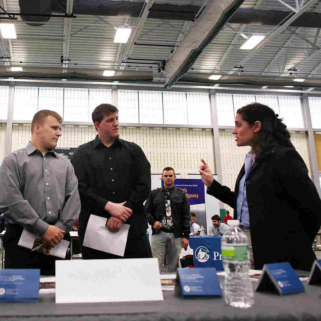 Military veterans Kris Hummel (l) and Shane Foley, speak with a TSA representative at a May 15, 2012 job fair in Utica, NY.