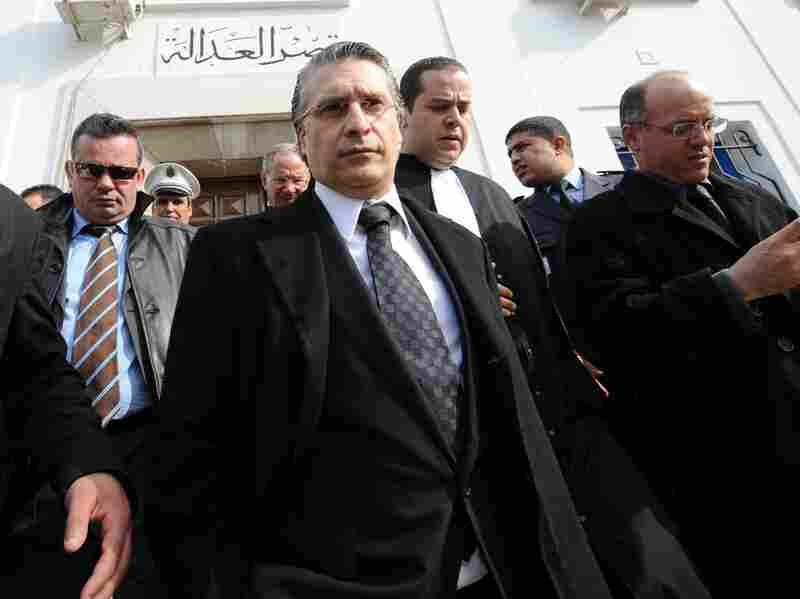 "Nabil Karoui, the director of the private Tunisian TV channel Nessma, had his offices and home attacked after his channel broadcast a film that angered Islamists. Karoui, shown here leaving a courthouse in Tunis, lost a case for ""violating morals."""