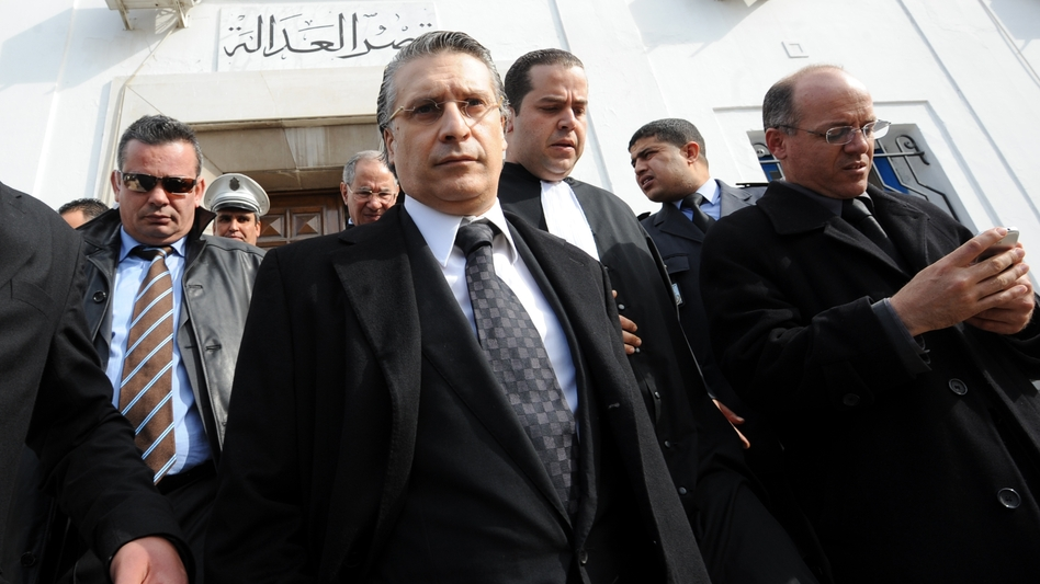 "Nabil Karoui, the director of the private Tunisian TV channel Nessma, had his offices and home attacked after his channel broadcast a film that angered Islamists. Karoui, shown here leaving a courthouse in Tunis, lost a case for ""violating morals."" (AFP/Getty Images)"