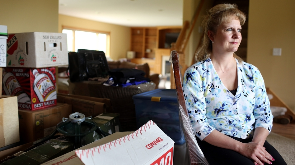 Cathy Yamauchi has been waiting since Thanksgiving to hear from her mortgage lender regarding a short sale of her home in Ramsey, Minn. She is planning to move to a townhome, but is mostly living out of boxes while waiting on the short sale. (MPR)