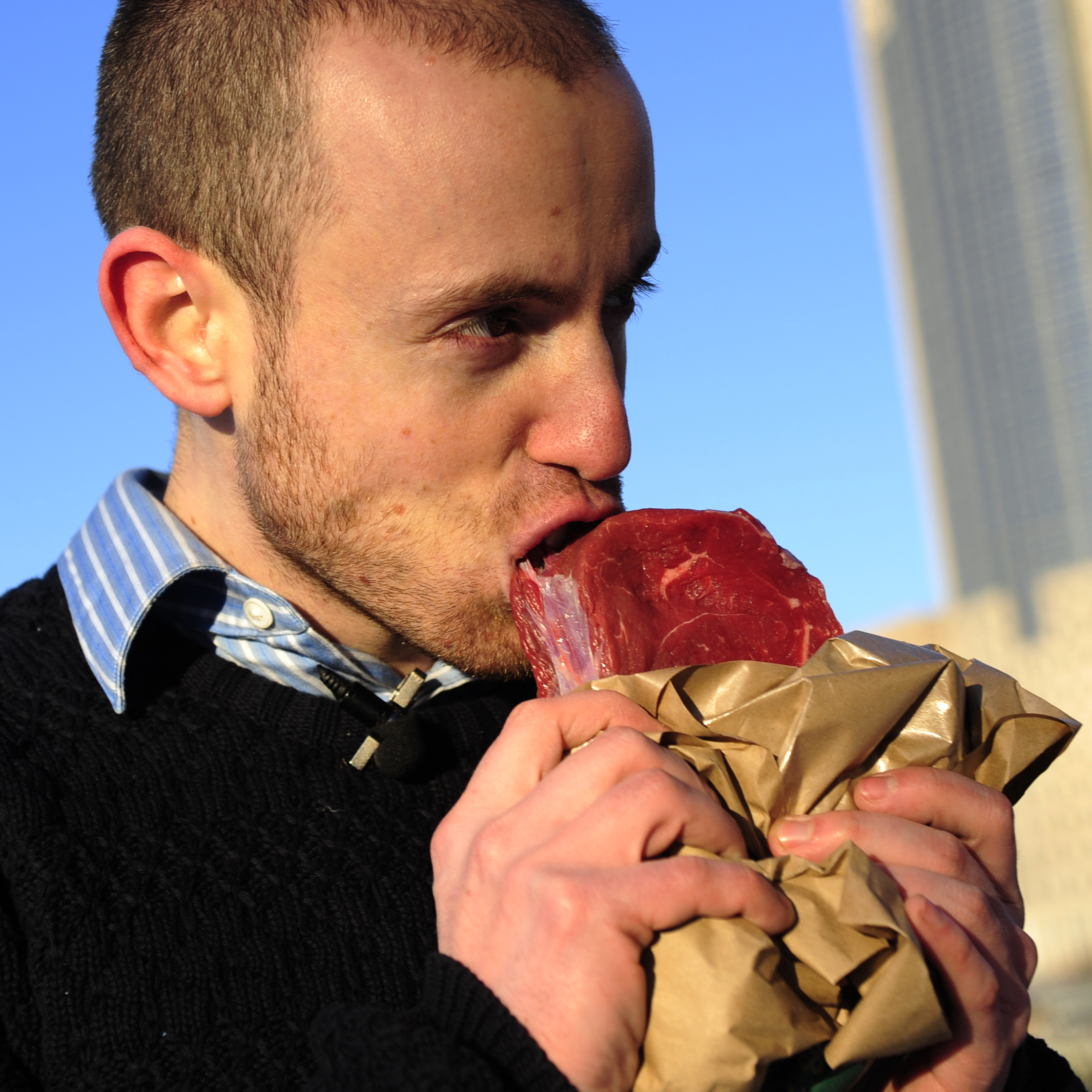 Vlad Averbukh, 29, a follower of the paleo diet, eats raw meat along the Hudson River in New York, February 04, 2010.