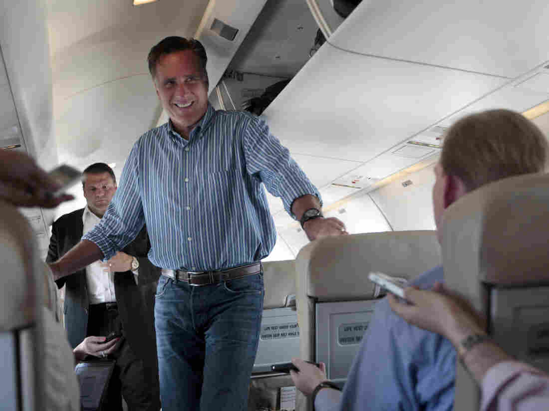 Republican presidential candidate Mitt Romney speaks to reporters on his campaign charter plane Monday in San Diego.