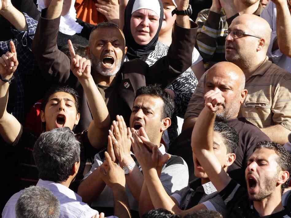 Syrians chant slogans outside the Othman Mosque in Damascus on May 12, 2012 during the funeral of victims of the twin bombings that happened in Damascus on May 10.