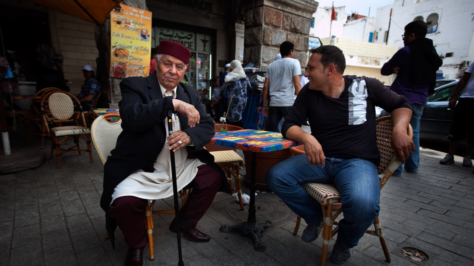 Since the revolution last year, Tunisians have had greater freedom to express their opinions on political and social issues. But the rise of Islamist groups has made religion a more sensitive topic. Here, two men chat at a cafe in the capital Tunis. (NPR)