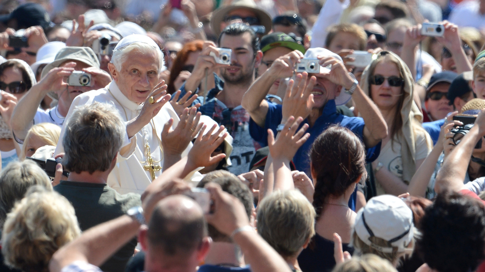 Pope Benedict XVI waves as he arrives for his weekly general audience on May 30 at St. Peter's Square at the Vatican. (AFP/Getty Images)