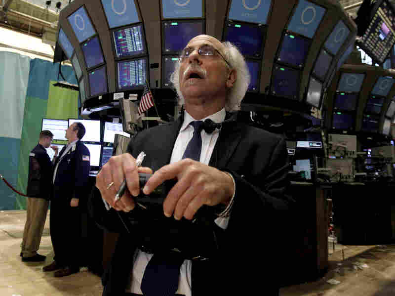 Trader Peter Tuchman works on the floor of the New York Stock Exchange at the close of trading Friday. The stock market suffered its worst day of the year after a surprisingly weak jobs report.