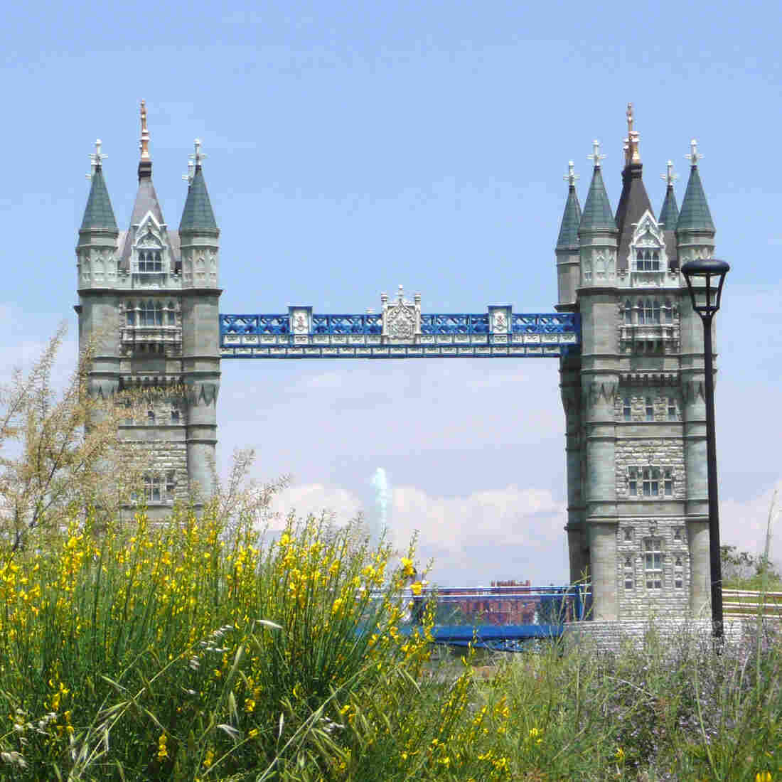 A model of London's Tower Bridge straddles a man-made river at the center of Spain's Parque Europa, a theme park replicas of the continent's most famous monuments.