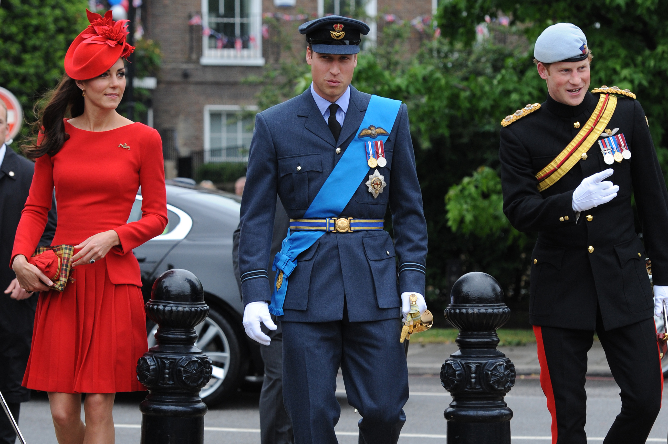 The queen's grandson Prince William and his wife, the Duchess of Cambridge -- he in his Royal Air Force uniform, she in a red Alexander McQueen dress -- and William's brother, Prince Harry, were among senior royals who joined the queen and her husband, Prince Philip.