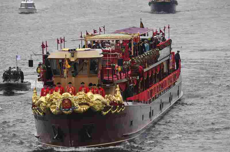 The queen traveled aboard the royal barge Spirit of Chartwell, decorated for the occasion in rich red, gold and purple velvet.