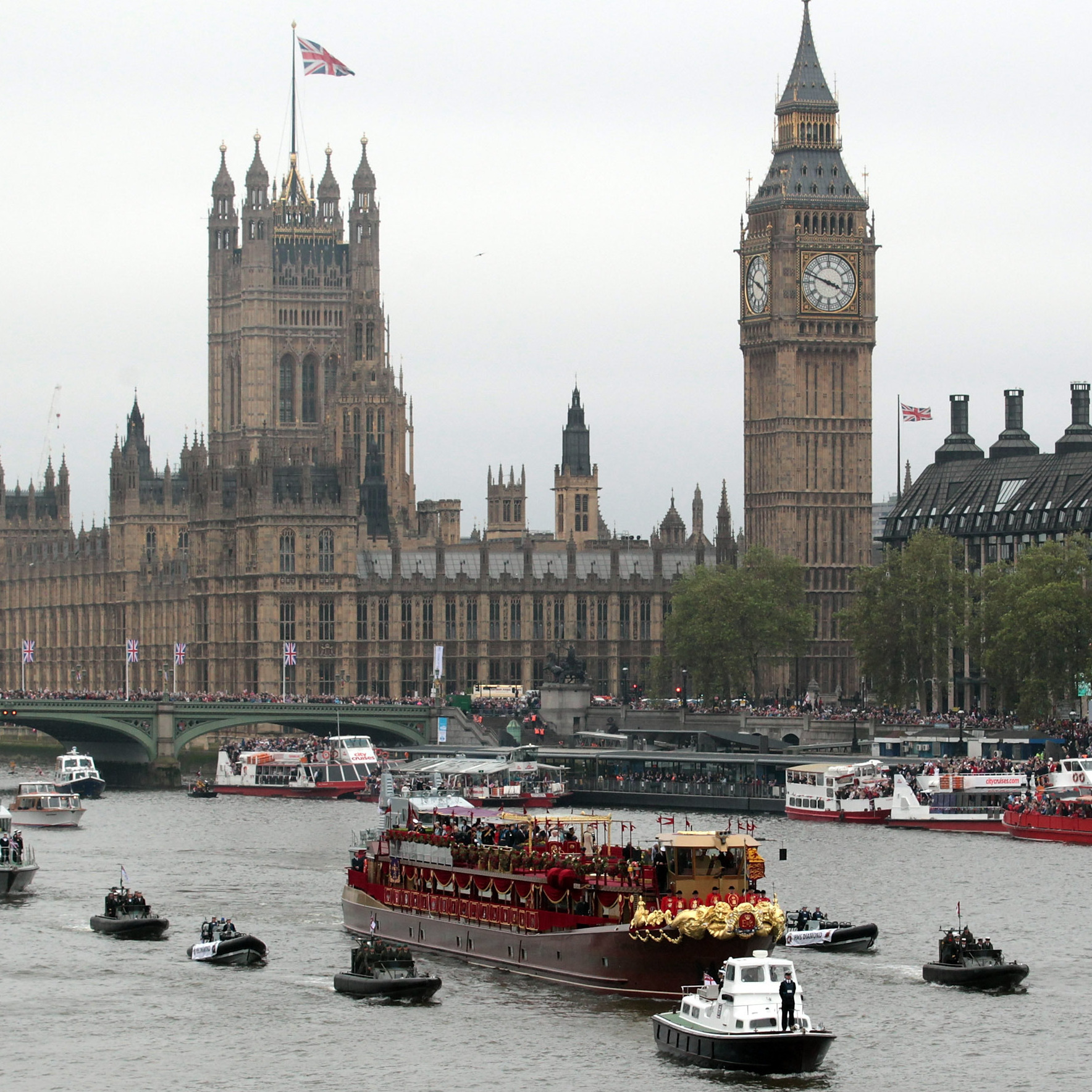 Thousands crowded the banks of the Thames today to catch a glimpse of Queen Elizabeth leading a flotilla of a thousand boats to mark her 60-year reign.