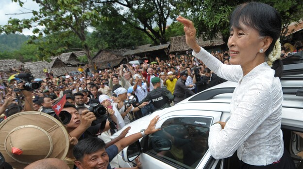 Myanmar democracy icon Aung San Suu Kyi waves to Myanmar refugees during her visit to the Mae La refugee camp near the Thai-Myanmar border on Saturday. (AFP/Getty Images)