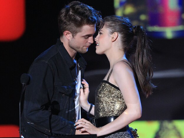 Robert Pattinson and Kristen Stewart accept the MTV Movie Award for Best Kiss (really!) at the 2010 ceremony.