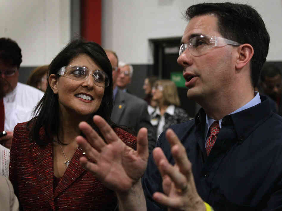 South Carolina Gov. Nikki Haley and Wisconsin Gov. Scott Walker tour Quad Graphics during a campaign stop for Walker in Sussex, Wis., last week.