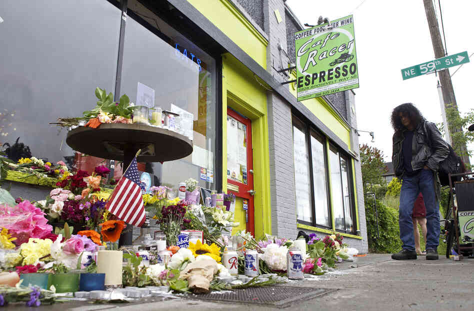 A memorial outside Seattle's Cafe Racer on Thursday, a day after a deadly shooting inside. Just a few days later, musicians gathered outside the coffeehouse for an improvised memorial jam session.