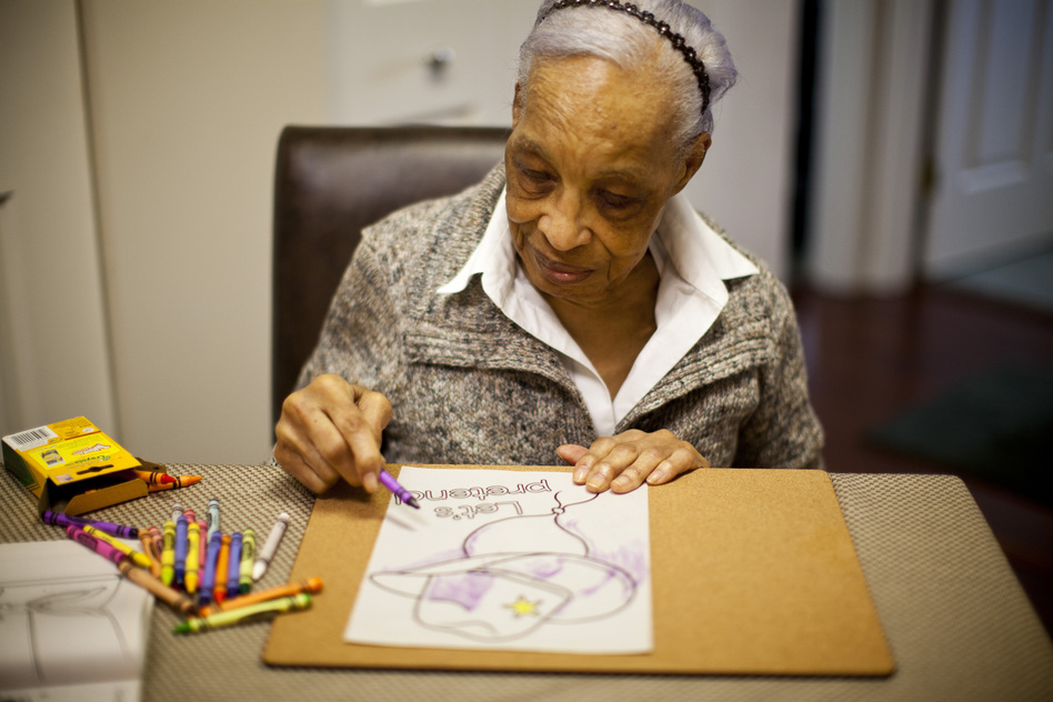 Maryland resident Ida Christian, 89, began showing symptoms of Alzheimer's disease in 2009. Her daughter, Geneva Hunter, and granddaughter, Yolanda, decided to take a hands-on approach to Ida's care. Ida lives with Geneva, and Yolanda quit her job to become Ida's daytime caregiver. (Kainaz Amaria/NPR)