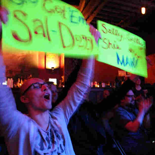The Ask Me Another crowd cheers for a contestant during a taping at Brooklyn's Bell House in New York.
