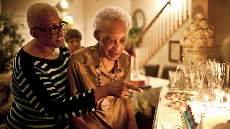Geneva Hunter (left), who runs the secretarial operations for a Washington, D.C., law firm, decided to take a hands-on approach to her mother's care and moved Ida Christian, 89, into her Maryland home.