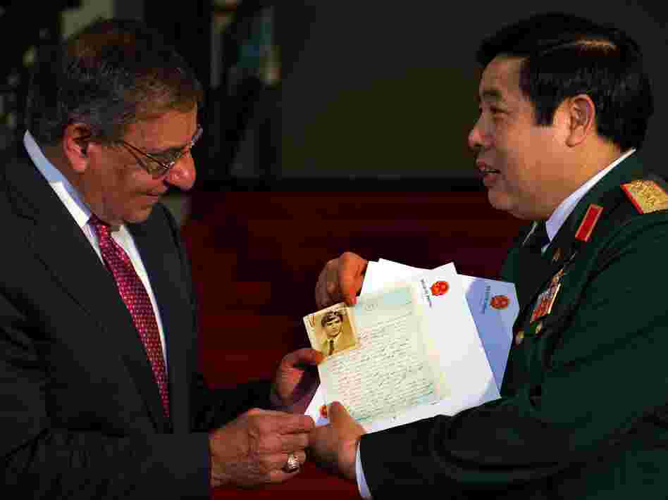 Vietnamese Minister of Defense Phuong Quang Thanh (right) presents the personal letters of U.S. Army Sgt. Steve Flaherty to Defense Secretary Leon Panetta.