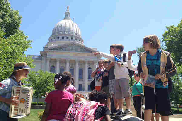 Fourth graders from Wauwatosa get a lesson in democracy while on a field trip to the state Capitol in Madison.