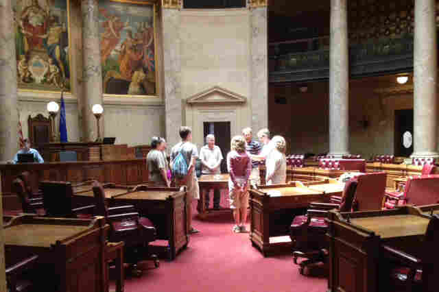 Wisconsin's Senate chamber, scene of so much partisan division this year, is quiet a day before the recall election, occupied only by a group of crystal spiritualists drawn by its beautiful round design.
