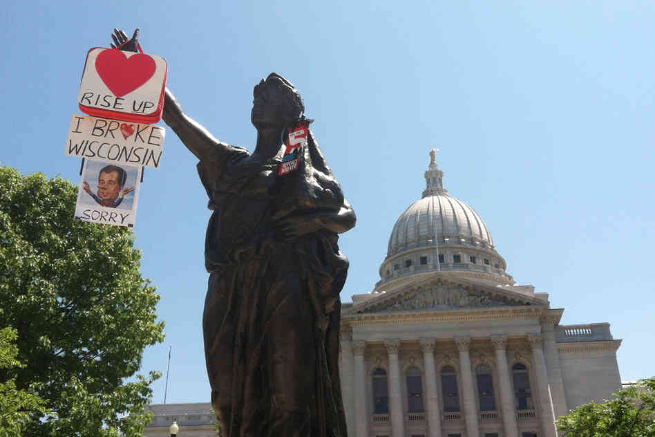 "The statue, ""Forward"", circa 1893, stands in front of the capitol building. ""Forward"" is the state motto, and both campaigns have been using that motion in their ads."
