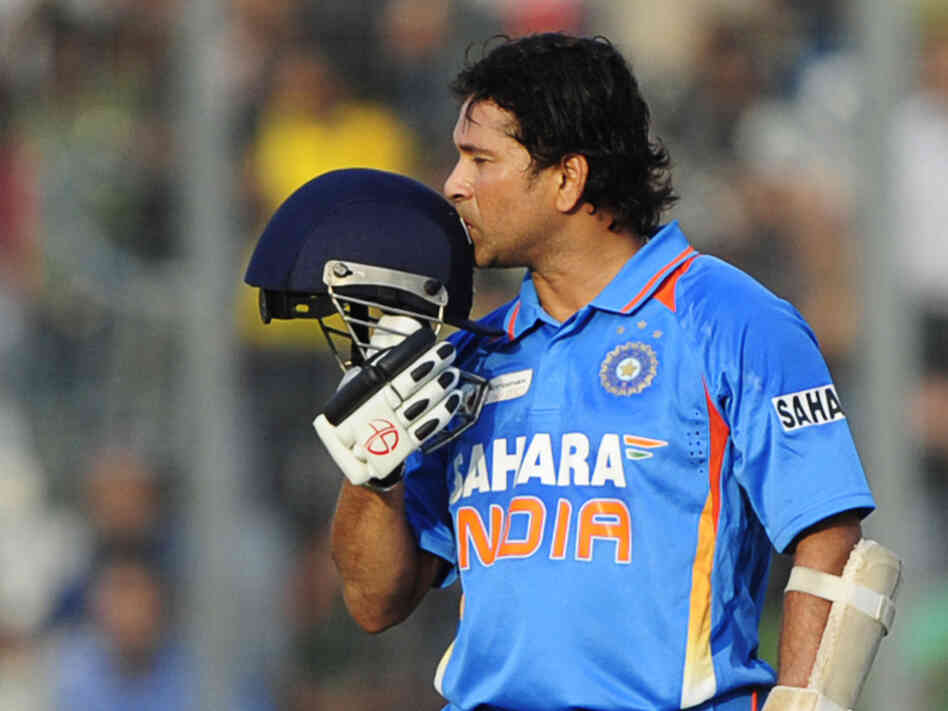 Sachin Tendulkar kisses his helmet after scoring his 100th century (100 runs) in a March match against Bangla