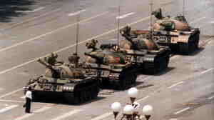 A Chinese protester, calling for an end to the violence against pro-democracy demonstrators at Tiananmen Square, blocks a line of tanks on June 5, 1989.