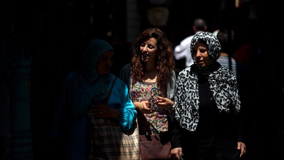 Tunisian women walk through the narrow streets of Tunis' medina, or marketplace. Compared to women in other Arab countries, Tunisian women have had access to education and job opportunities for decades. (NPR)