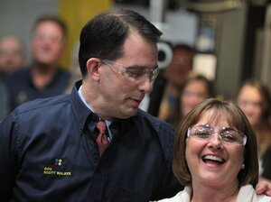 Wisconsin Governor Scott Walker and his wife First Lady Tonette Walker make a campaign stop at Quad Graphics June 1, 2012 in Sussex, Wisconsin. Walker will face Democratic contender Milwaukee Mayor Tom Barrett in a recall election on June 5.