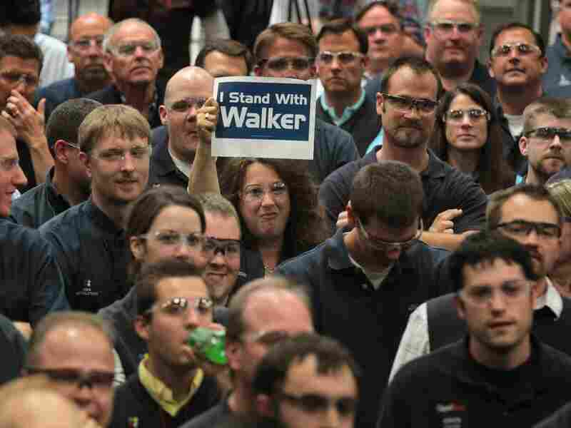 A worker at Quad Graphics shows her support during a campaign stop by Wisconsin Governor Scott Walker on June 1, 2012 in Sussex, Wisconsin. Walker will face Democratic contender Milwaukee Mayor Tom Barrett in a recall election on June 5.