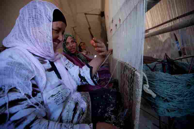 Workers at a carpet-making business in the town of Kairouan are paid about $2.50 a day. Many carpet buyers are tourists, but the number of foreign visitors has dropped since the revolution.