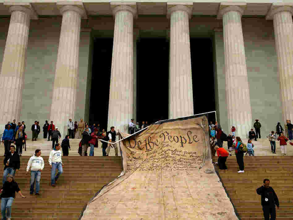 Volunteers unfurl a banner  with the Preamble to the Constitution during a demonstration against the Supreme Court's Citizens United ruling on campaign finance rules at the Lincoln Memorial in Washington, D.C., Oct. 20, 2010.
