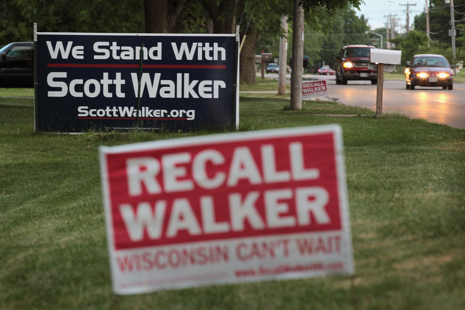 Neighbors display signs with opposite views in Beloit. (Getty Images)