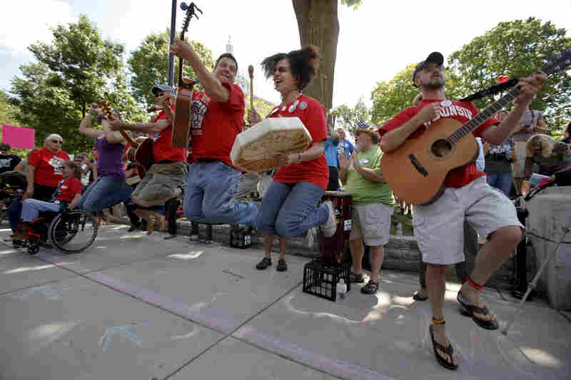 The Solidarity Singers play union songs in support of recalling Walker near the Capitol in Madison.