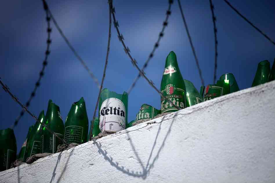 The wall surrounding the Celtia brewery is about 12-feet high and topped with razor wire and broken beer bottles. The brewery is owned by the state, and the government is currently controlled by the Islamist party Ennahda.