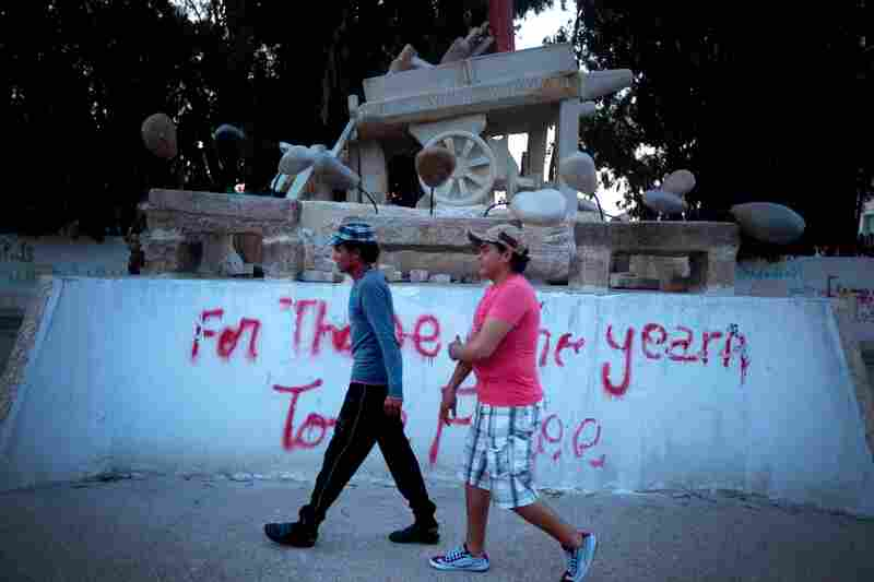 """A monument to Mohammed Bouazizi, a fruit seller who touched off the Arab Spring by setting himself on fire in the central Tunisian town of Sidi Bouzid. The graffiti reads, """"For Those Who Yearn To Be free."""""""
