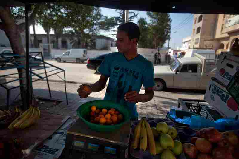 A vendor sells fruit in the same market area where  Bouazizi worked.