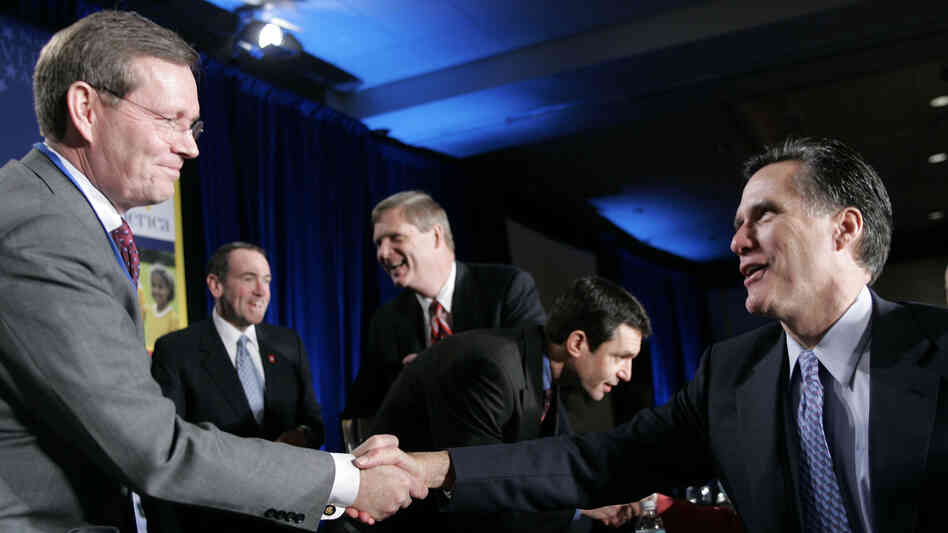 Mitt Romney (right), at the time the governor of Massachusetts, greets then-Health and Human Services Secretary Mike Leavitt during a National Governors Association
