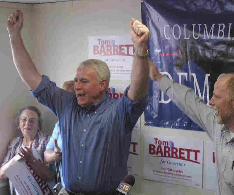 Democrat Tom Barrett rallies supporters inside his campaign office on Monday in Portage, Wis.