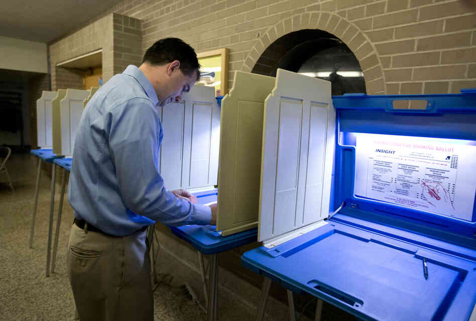 Walker votes in Wauwatosa. He is trying to become the first U.S. governor to successfully fend off a recall.