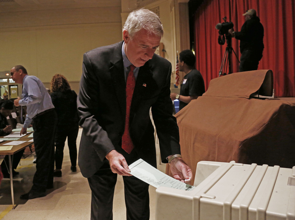 Barrett puts his ballot into a machine after voting in Milwaukee. (AP)