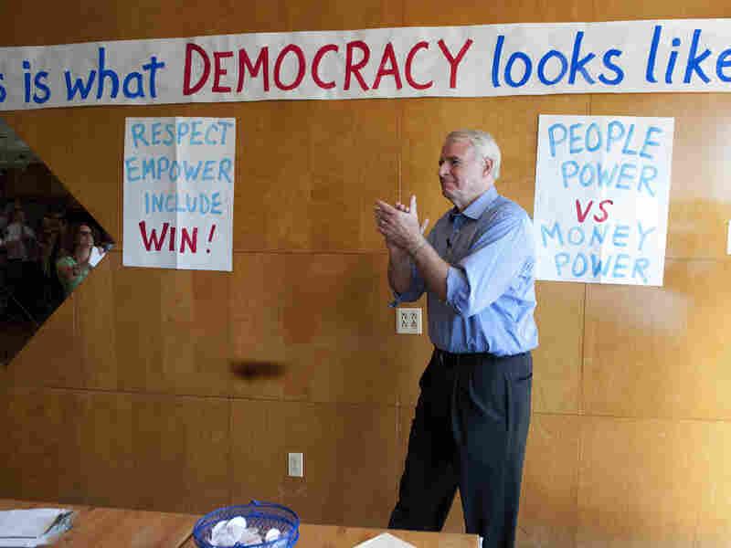 Milwaukee Mayor Tom Barrett, Democratic challenger to Republican Gov. Scott Walker, greets supporters Tuesday in Racine, Wis.