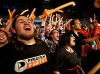 Supporters of the Pirate Party react after early results are announced during elections in Duesseldorf, Germany, on May 13.