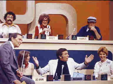 The participants on an early episode of Match Game, including Richard Dawson in the lower center position.