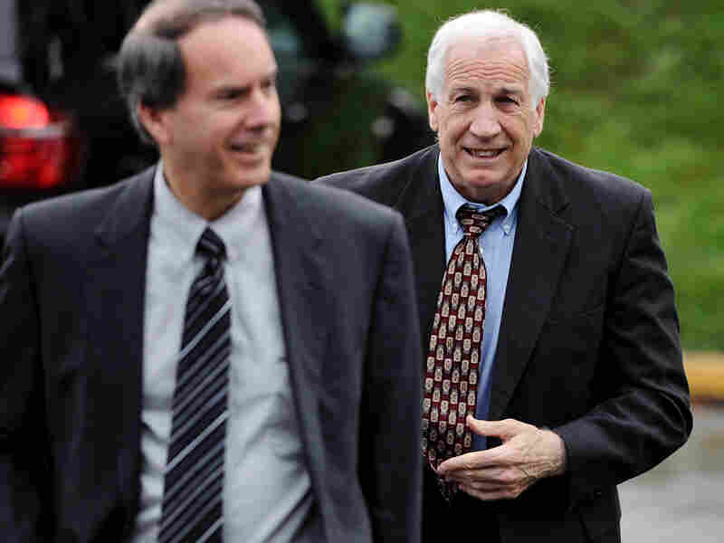 Former Penn State football assistant coach Jerry Sandusky (right) walks to the county courthouse on June 5, the first day of his trial on child sex abuse charges.